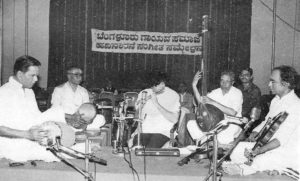 BN Suresh - back to stage on a chair