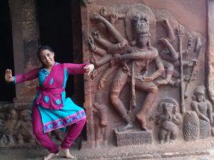 Dr. Manorama BN with the sculpture of Mahanata at Badami